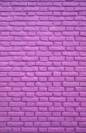 Vertical Image of Purple Pink Colored Aging Brick Wall Stock Photo