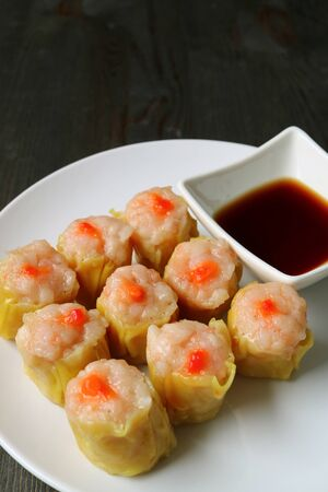 Vertical Image of Shrimp and Pork Filled Chinese Steamed Dumplings or Shumai 写真素材