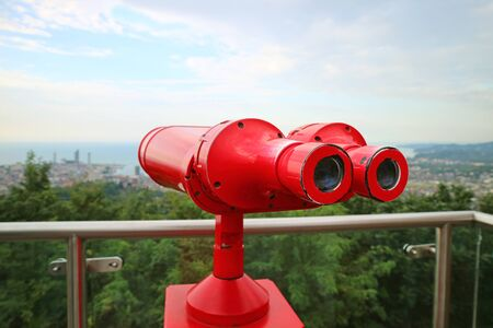 Closeup Vivid Red Binoculars on the Observation Deck with Copy Space Banque d'images