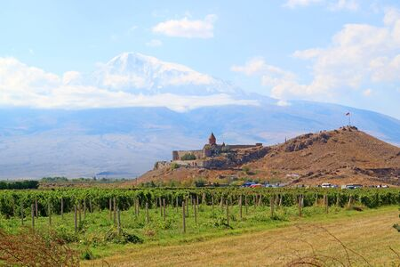 Stunning View of Khor Virap Monastery against Snow Capped Mount Ararat and a Vineyard in Foreground, Armenia