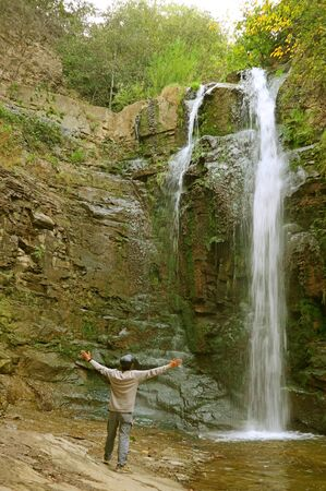 Visitor Impressed with Leghvtakhevi Waterfall, One of the Popular Attractions in the Old District of Tbilisi, Georgia