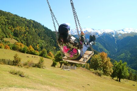 Woman Enjoy the Swing with Amazing Panoramic View of Caucasus Mountain in Mestia, Svaneti Region of Georgia