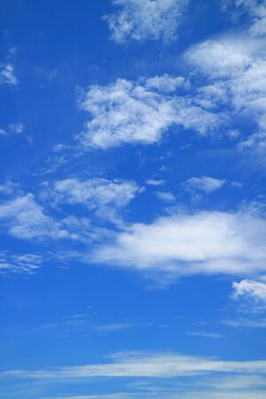 Vertical image of vivid blue sky with pure white clouds Reklamní fotografie