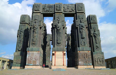 Man Visiting the Chronicle of Georgia, a Breathtaking Massive 16 Pillars Approx. 30 Meter Tall Monument near Tbilisi of Georgia