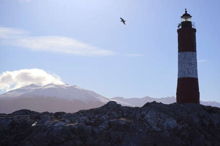 Les Eclaireurs lighthouse on a rocky islands in Beagle channel, the iconic landmark of Ushuaia, Tierra del Fuego, Patagonia, Argentina