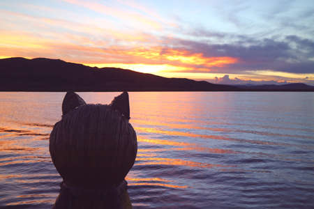 Puma Head Prow of the Traditional Totora Reed Boat against Lake Titicaca at Beautiful Sunset, Puno, Peru, South America