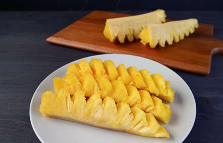 Slices of fresh ripe pineapple in a white plate ready to serve Zdjęcie Seryjne