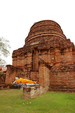 The Historic Stupa(Chedi) Ruins with a Reclining Buddha Image in Wat Yai Chai Mongkhon Temple, Ayutthaya, Thailand Stock Photo
