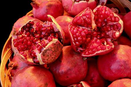 Closeup Vibrant Red Opened Fresh Pomegranate Fruits on the Whole Fruit Pile Imagens