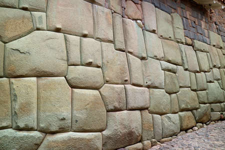 Amazing Stonework of the Inca Wall on Hatun Rumiyoc Street, the Ancient Street in Historic Centre of Cusco, Peru, South America