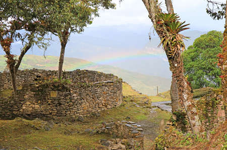 Ancient Stone Round House Ruins on the Hilltop Inside Kuelap Archaeological Complex with the Gorgeous Rainbow, Amazonas Region, Northern Peru