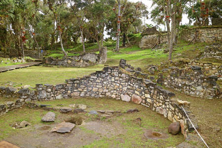 Stone round house ruins inside the lost city of ancient Kuelap fortress, archaeological site in Amazonas region of northern Peru