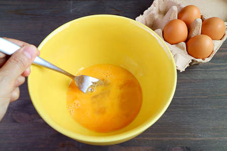 Egg Being Beaten in a Mixing Bowl for the Concept of HOME COOKING 免版税图像