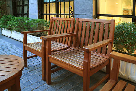 Empty wooden chairs in the garden 免版税图像