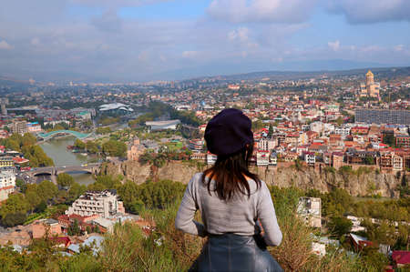 Woman Enjoy Stunning Aerial View with Many of Iconic Landmarks of Tbilisi, the Capital City of Georgia 免版税图像