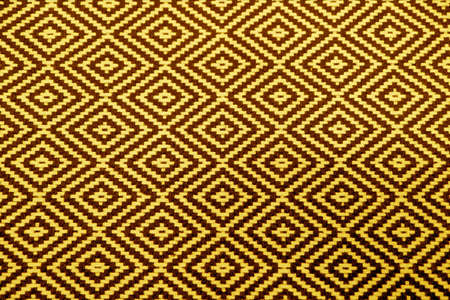 Yellow and Brown Geometric Pattern of Ethnic Fabric for Abstract Background