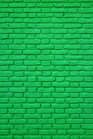 Vertical Photo of Vivid Green Colored Old Brick Wall for Background and Wallpaper 免版税图像