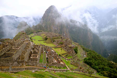 Machu Picchu in the Light Rain, the Incredible Inca Citadel in Urubamba Province, Cusco Region, Peru 免版税图像