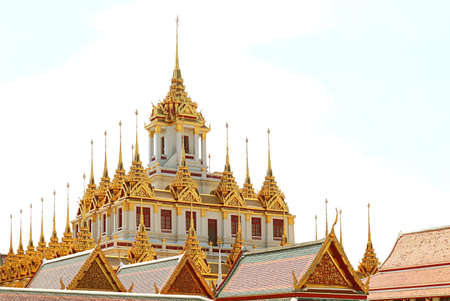 Fantastic Golden Spires of the Historic Loha Prasat (Iron Castle) inside Wat Ratchanatdaram Temple Located in Bangkok Old City, Thailand Imagens