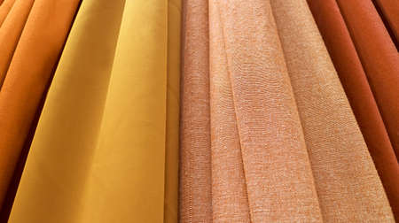 Fabrics in luxurious gold and brown color gradient Imagens
