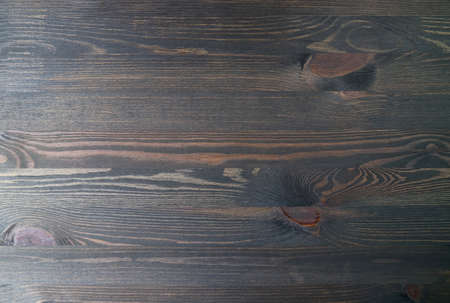 Top view of dark brown natural wooden plank for background and wallpaper Imagens