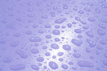 Pop art style pastel lavender colored water droplets on the tabletop after the rain Imagens