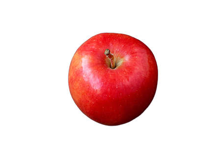 Fresh ripe vibrant red apple isolated on white backdrop