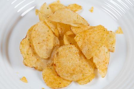 Paprika crisps on a white plate