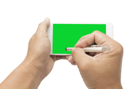 signing on green screen smartphone Stock Photo
