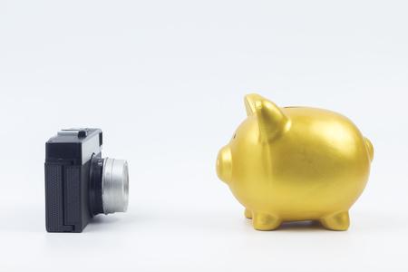 holiday budget: concept : saving travel gold piggy bank selfie Stock Photo