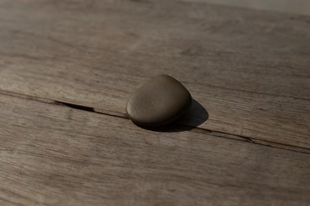 stones isolated: Stones isolated on wood