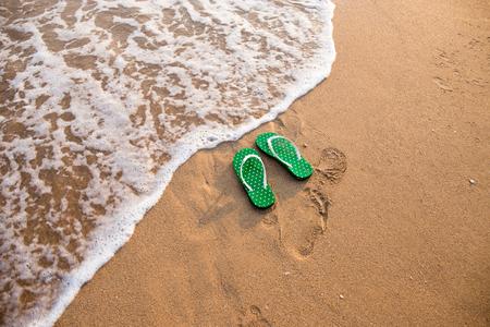 flip flops: Flip flops on beach ocean