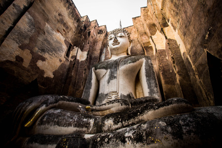 past civilizations: ancient buddha statue. sukhothai historical park thailand Stock Photo