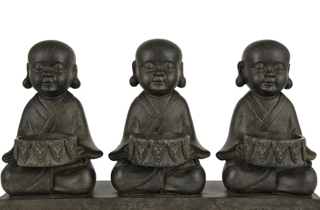 veneration: sculpture of three Buddha in lotus position