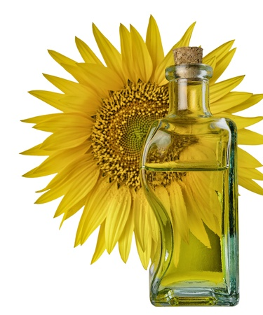 bottle with oil and sunflower in background