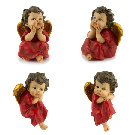 four angels in red and gold isolated Stock Photo