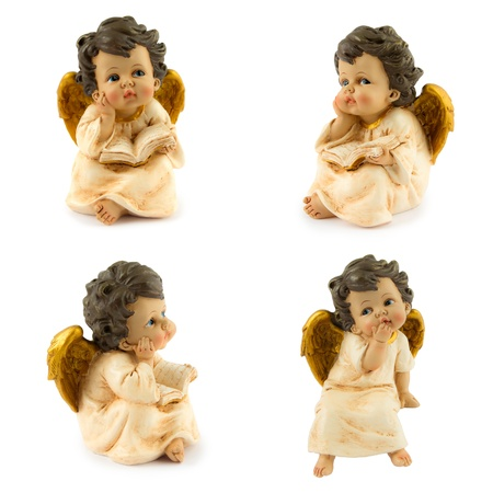 four angels in white and gold isolated