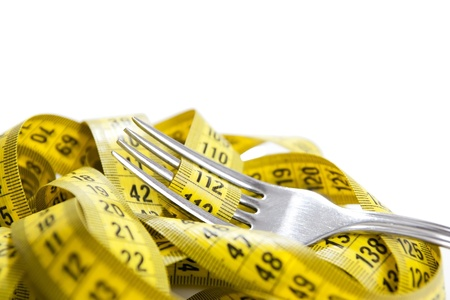 Fork with measuring tape isolated Stock Photo