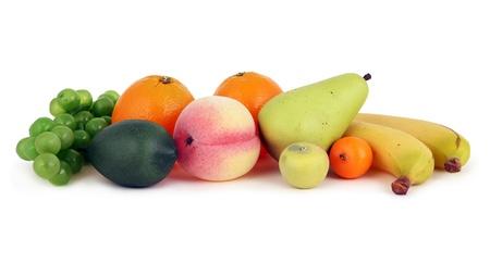 Mixed fruits: pear, peach, bananas, lemon and grape