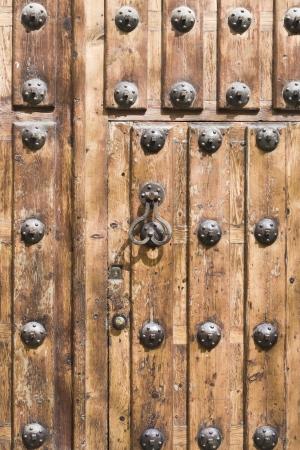 old wooden door with knocker Stock Photo - 14392114