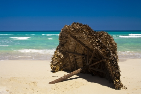 beach with umbrella in the caribbean