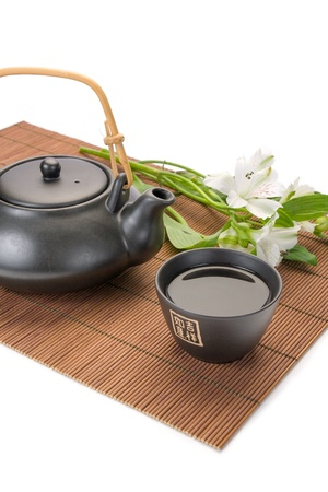 Black asian teapot and cup
