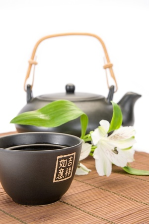 Asian teapot and cup close-up Stock Photo