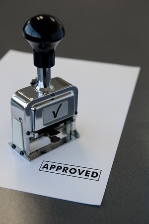 a pproved stamp in a paper
