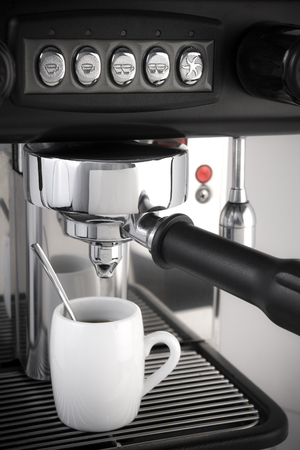 Espresso coffee maker with cup and spoon