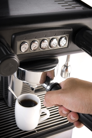 Espresso coffee maker with hand