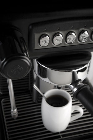 Coffee maker machine with cup