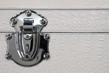 Trunk lock in metal and  white leather