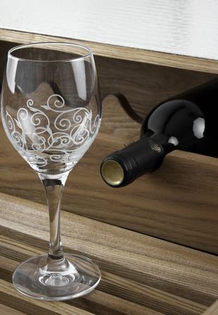 Wine bottle and glass in bar Standard-Bild