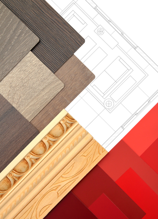 Interior design work table with drawing, moldings and color and wood samples